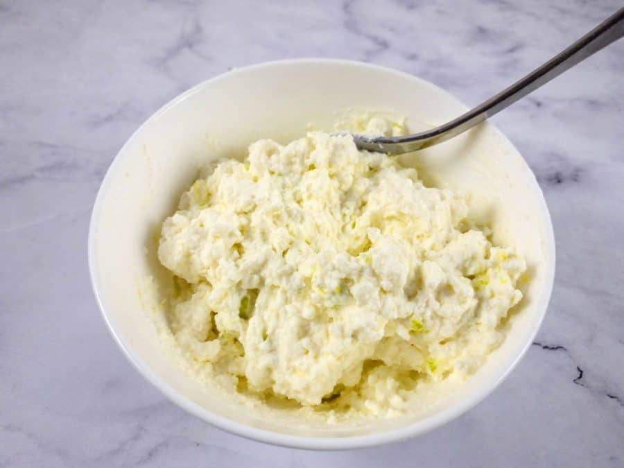 MIXING RICOTTA AND ZEST IN BOWL