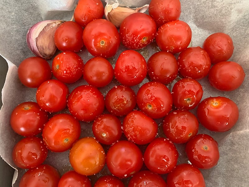 RAW CHERRY TOMATOES ON A TRAY WITH OIL