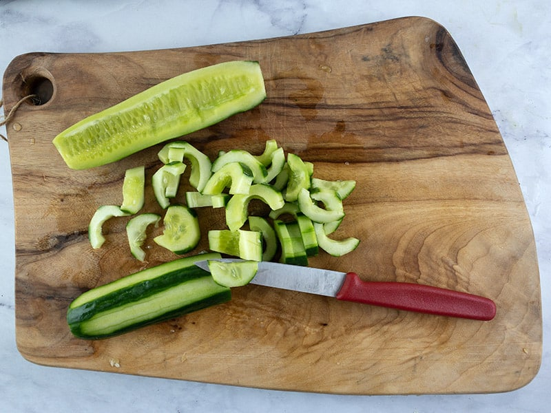 CUTTING-CUCUMBERS-INTO-HALF-MOONS