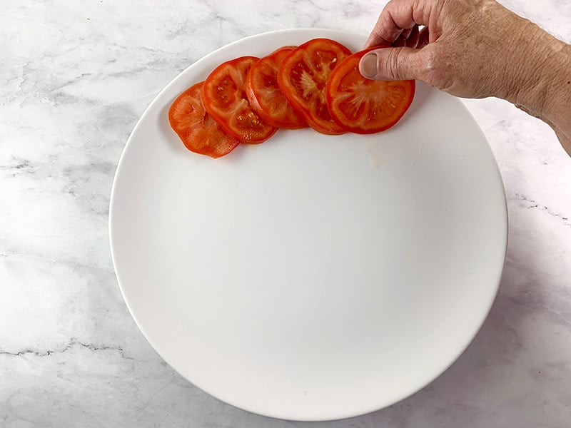 ARRANGING-SLICED-TOMATOES-ON-A-PLATTER