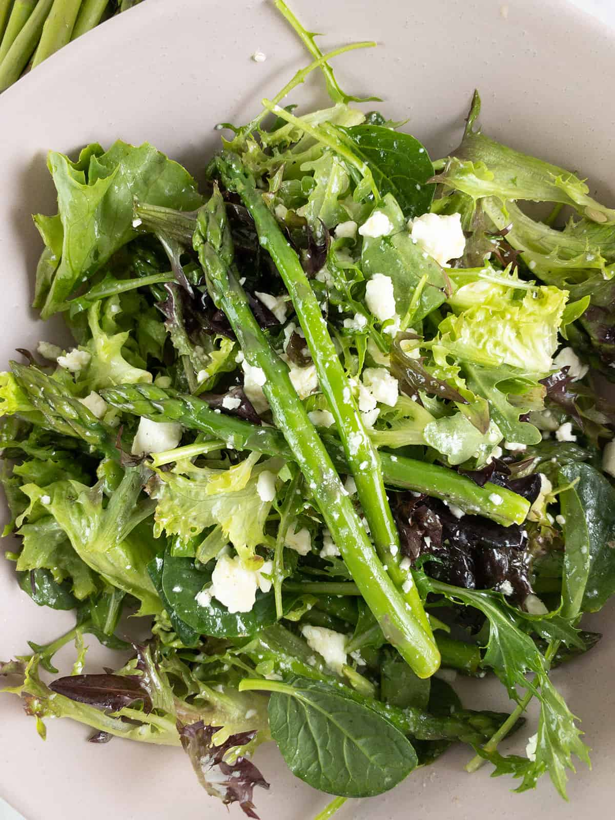CLOSE-UP OF BLANCHED ASPARAGUS AND FETA SALAD