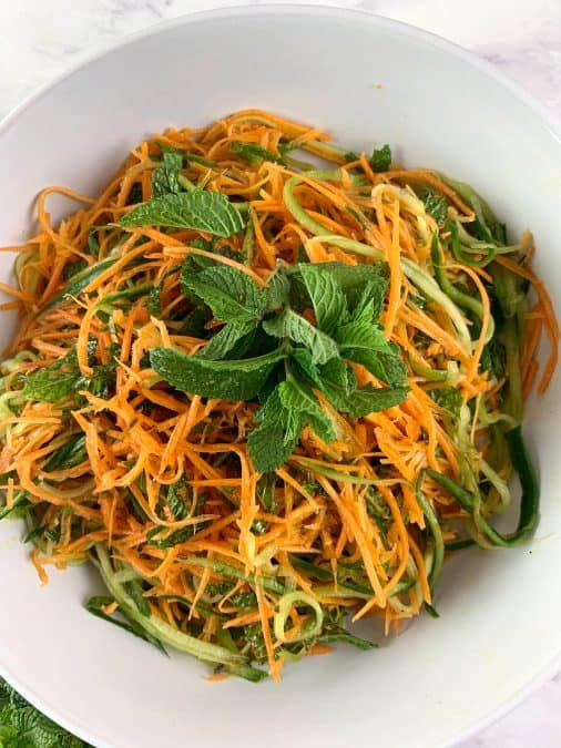 CLOSE UP OF AROMATIC CUCUMBER & CARROT SALAD