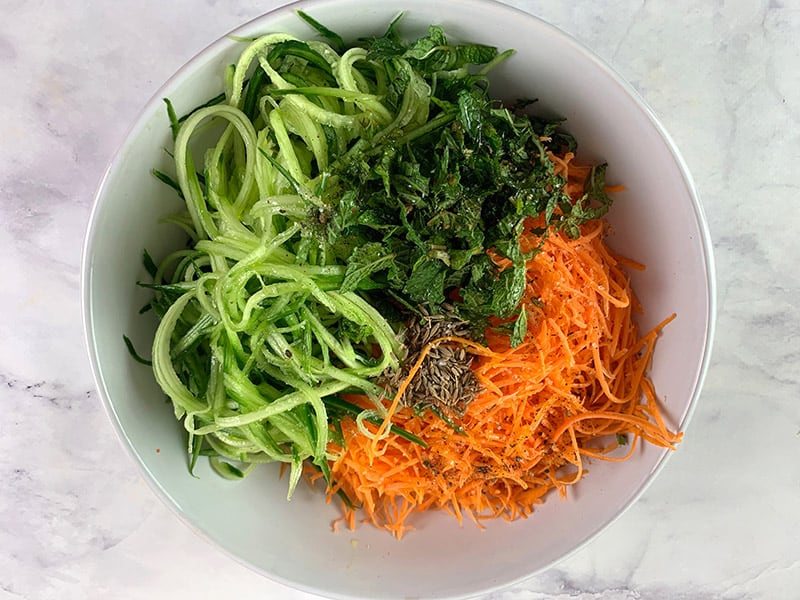 INGREDIENTS-IN-BOWL-FOR-AROMATIC-CUCUMBER-&-CARROT-SALAD