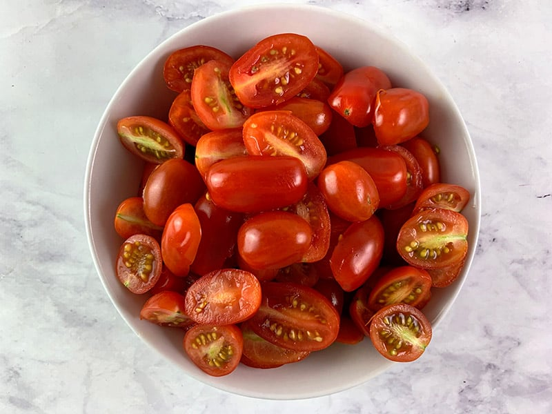 CUT YOUR MINI ROMA TOMATOES IN HALF