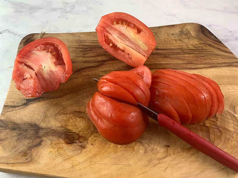 CUTTING TOMATOES INTO WEDGES