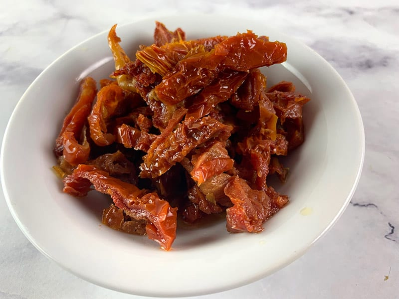 CUT YOUR SUN DRIED TOMATOES IN STRIPS