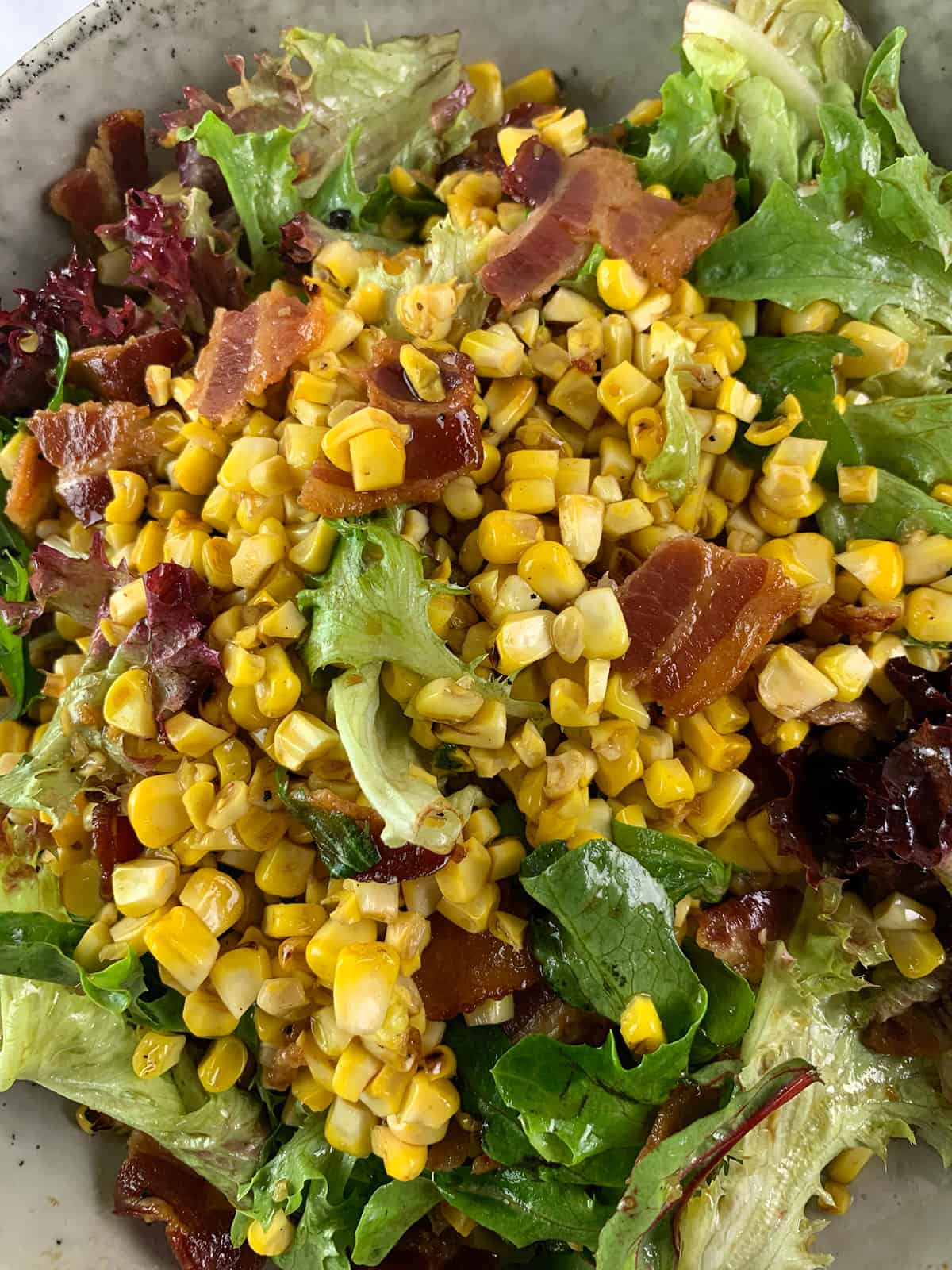 CLOSE UP OF GRILLED CORN SALAD IN PORTRAIT VIEW