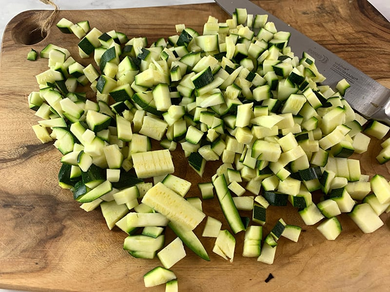 DICING ZUCCHINI ON WOODEN BOARD