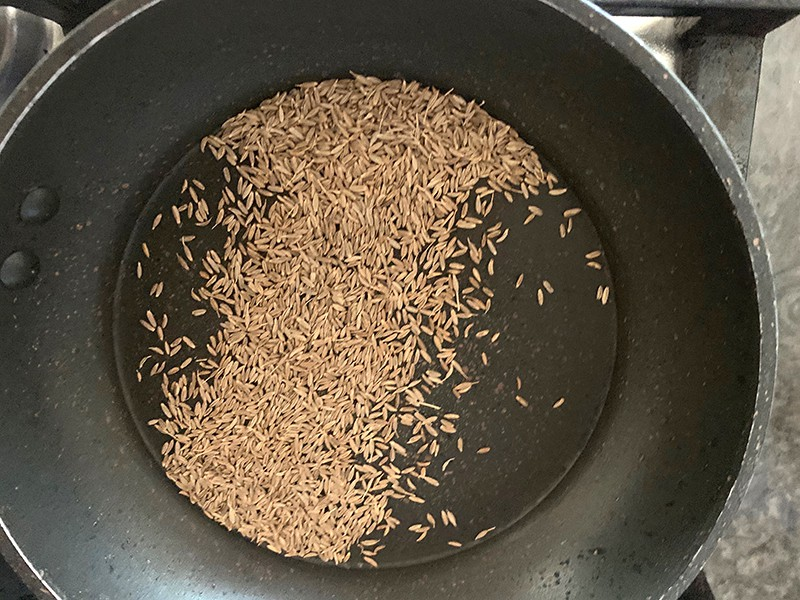 CUMIN SEEDS IN A HOT PAN
