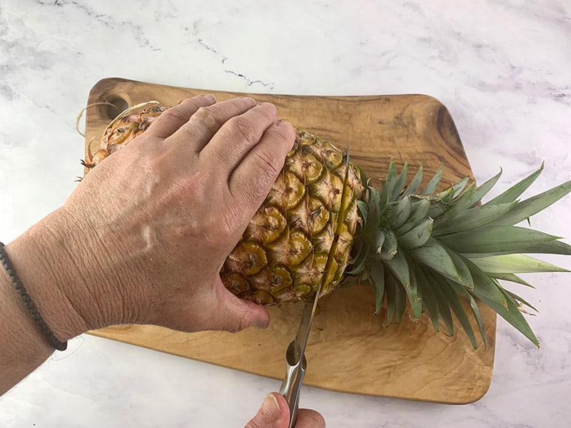 CUTTING THE CROWN FROM A PINEAPPLE