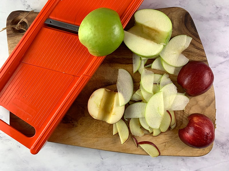 THINLY SLICING RED AND GREEN APPLES USING A MANDOLINE SLICER