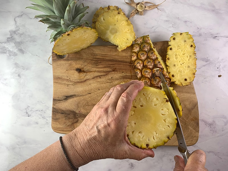 CUTTING PRICKLY SKIN FROM PINEAPPLE