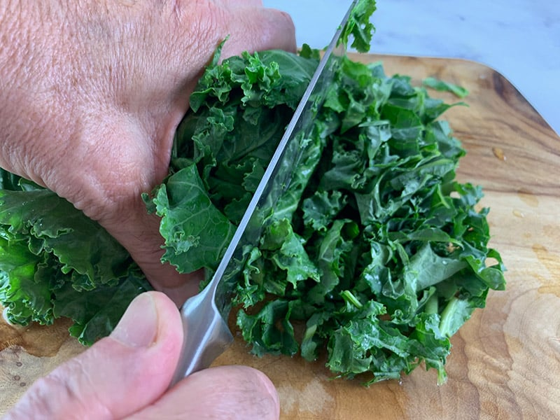 SHREDDING KALE WITH A SHARP KNIFE