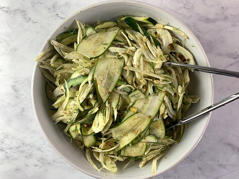 TOSSING SHAVED FENNEL SALAD TO COMBINE