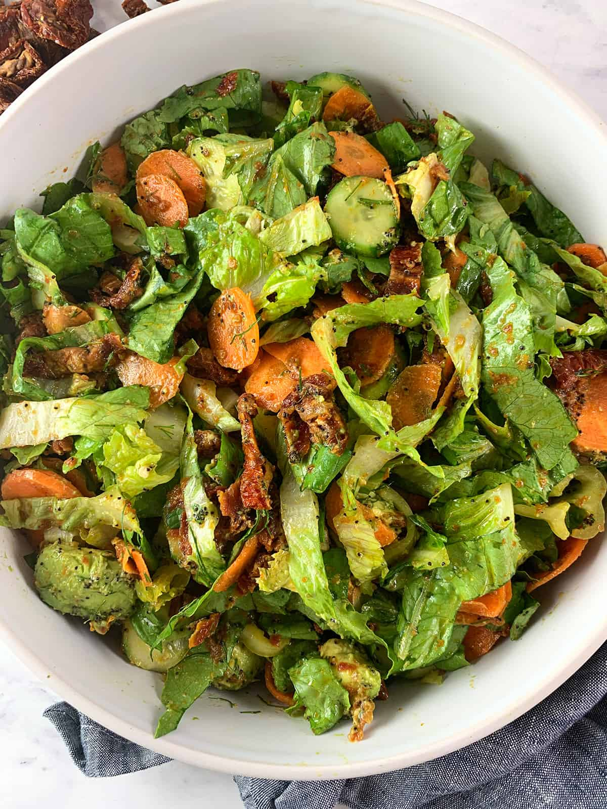 CLOSE-UP OF DRIED TOMATOES SALAD IN PORTRAIT