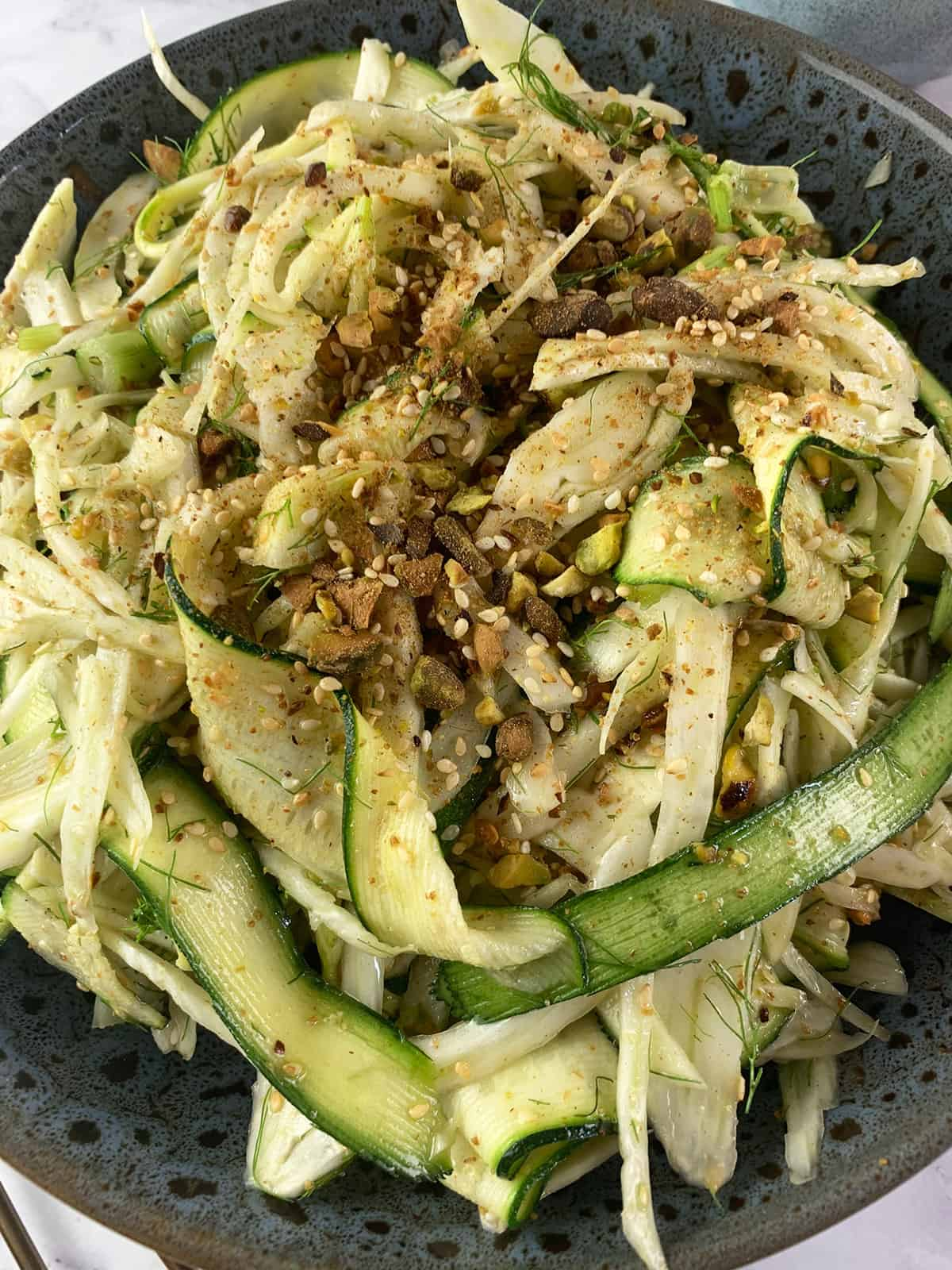 CLOSE UP OF SHAVED FENNEL SALAD IN PORTRAIT