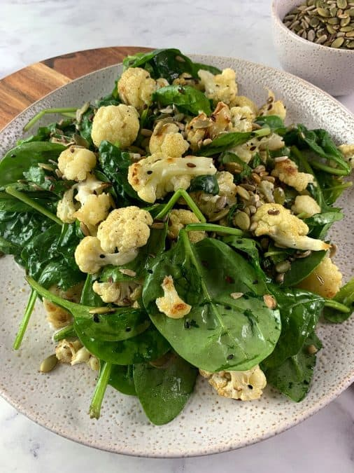 ROAST CAULIFLOWER SALAD IN PORTRAIT AT AN ANGLE