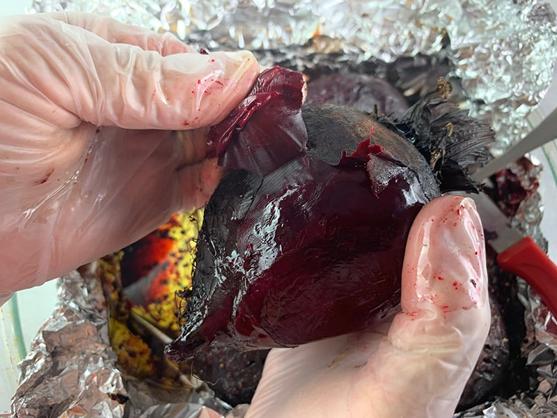 PEELING ROASTED BEETS WITH GLOVED HANDS
