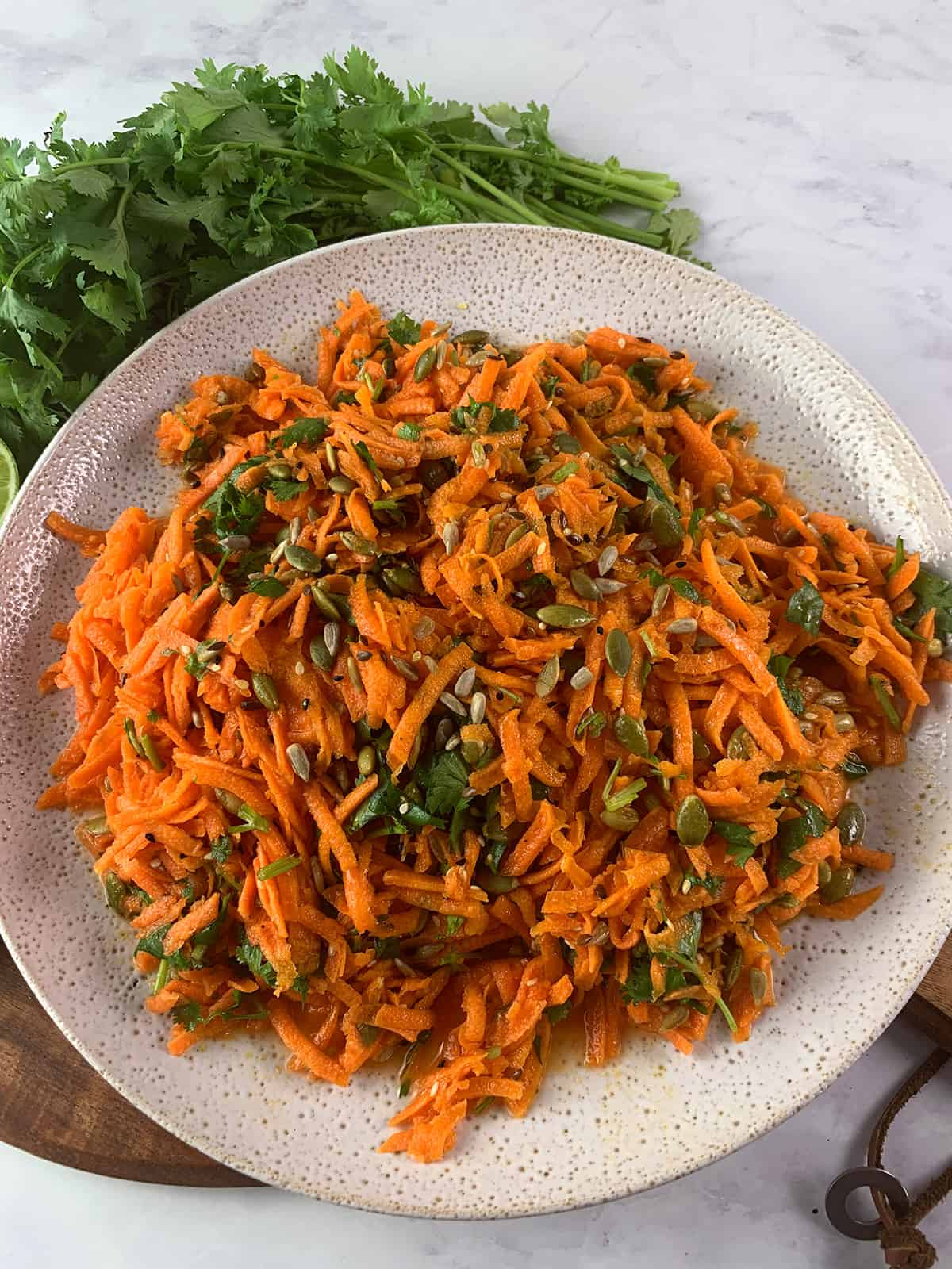 SHREDDED CARROT SALAD CLOSE UP IN PORTRAIT