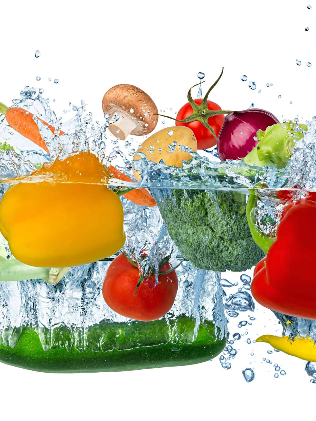 A VARIETY OF MIXED VEGGIES SPLASHING IN WATER