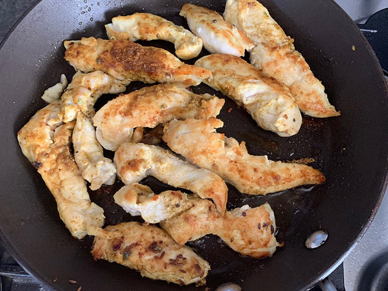 FRYING CHICKEN TENDERS IN A PAN