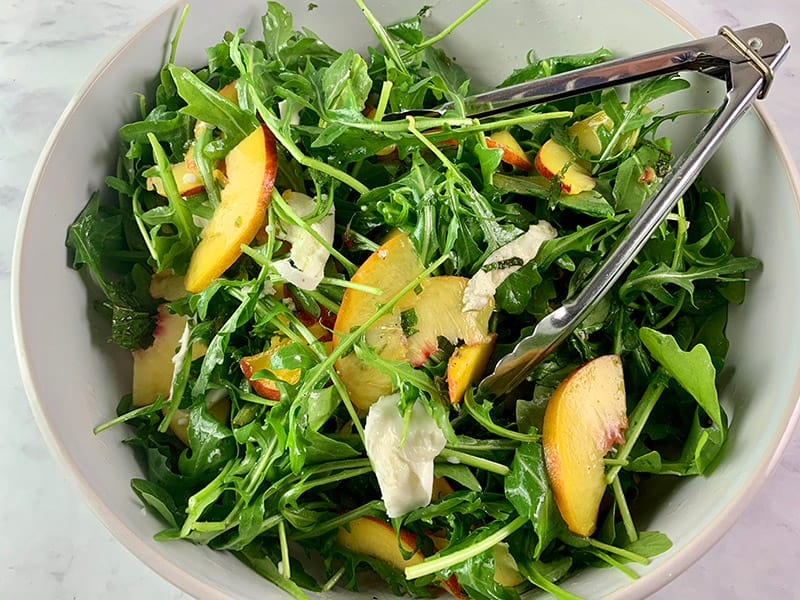 TOSSING PEACH SALAD TOGETHER