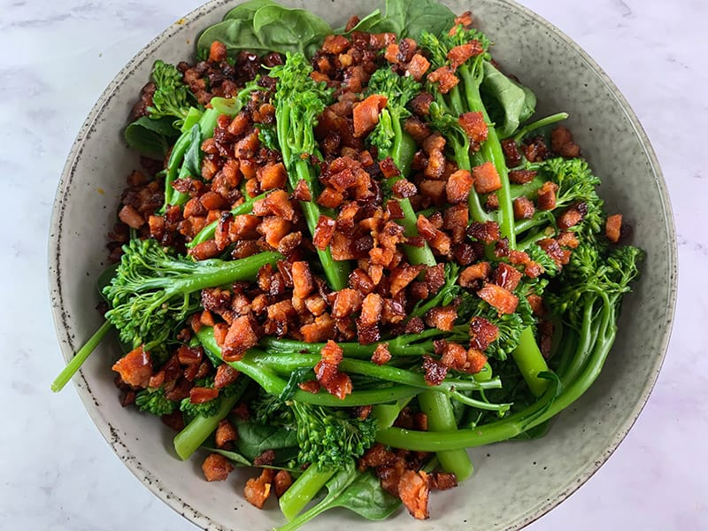 SCATTERING DICED FRIED CHORIZO ON TOP OF BROCCOLINI