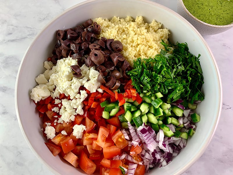 CHOPPED MEDITERRANEAN COUSCOUS SALAD INGREDIENTS IN A BOWL