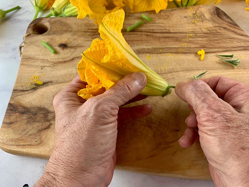 REMOVing THE SPINY LEAVES from a zucchini flower