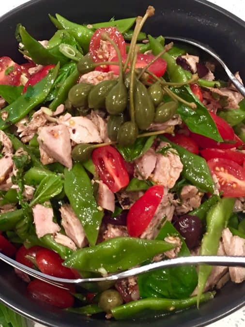 CLOSE UP OF GRILLED TUNA SALAD WITH FLAT BEANS, CAPERBERRIES AND CHERRY TOMATOES
