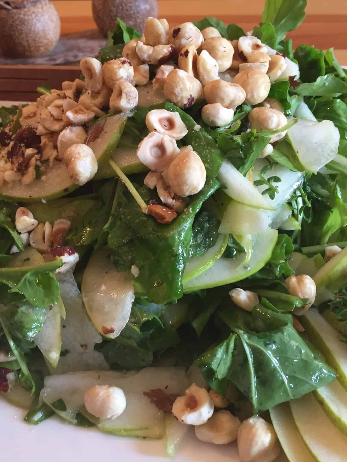 ARUGULA PEAR SALAD WITH HAZELNUTS & VERJUICE