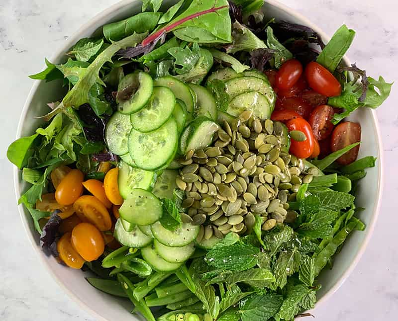 ALL THE INGREDIENTS FOR SPRING MIX SALAD IN A BOWL