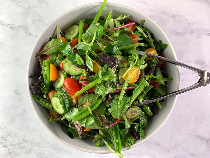 TOSSING SPRING MIX SALAD WITH DRESSING