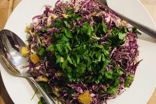 SHAVED PURPLE BRUSSELS SPORUTS WITH ORANGE AND POPPY SEEDS WITH PARSLEY GARNISH
