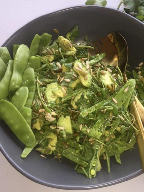 snow pea salad with avocado, seeds and dijon vinaigrette