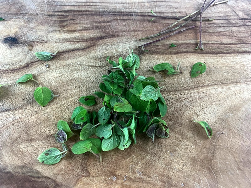 PICKING OREGANO LEAVES FROM STEMS
