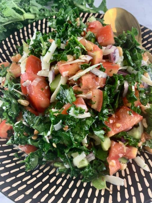CLOSE UP IN PORTRAIT OF CHOPPED KALE SALAD