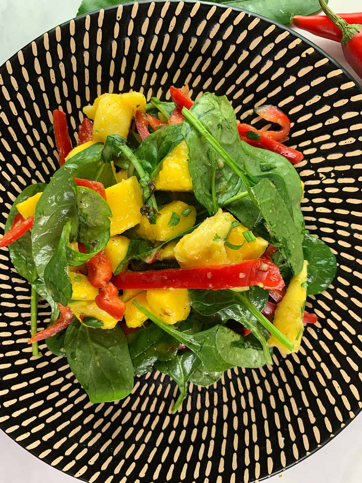 CLOSE UP OF THAI MANGO SALAD IN PORTRAIT