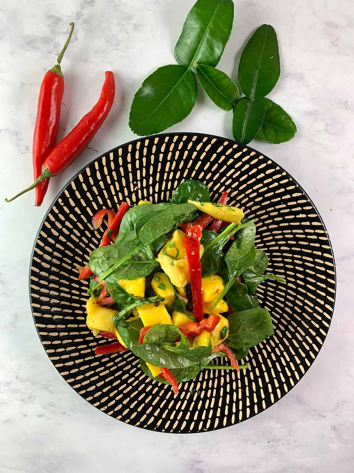 AERIAL OF THAI MANGO SALAD IN PORTRAIT