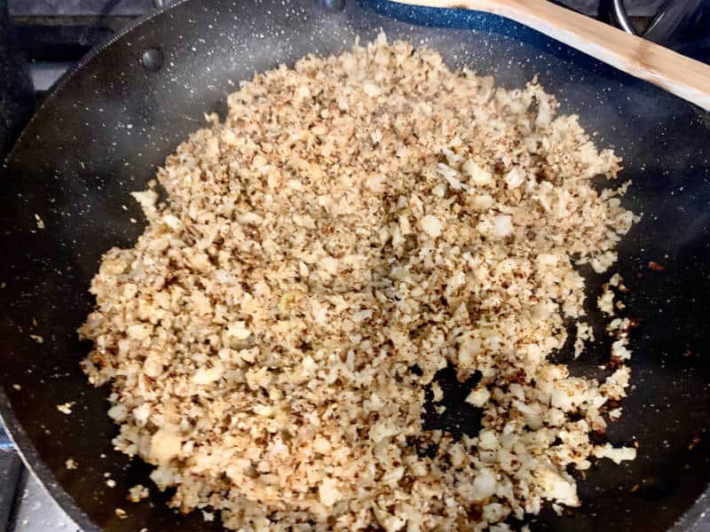 STIRRING ZAATAR THROUGH RICED CAULIFLOWER UNTIL AROMATIC