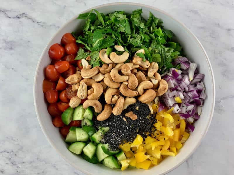 CHOPPED ASIAN SALAD INGREDIENT IN A WHITE BOWL