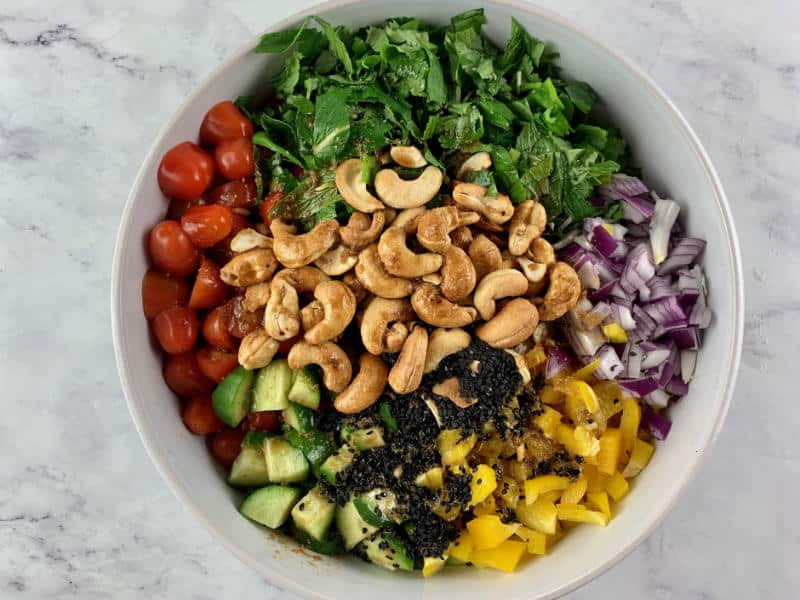 09-CHOPPED ASIAN SALAD INGREDIENTS WITH DRESSING IN A WHITE BOWL