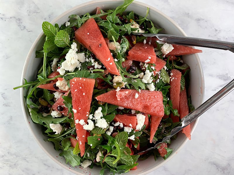 TOSSING WATERMELON SALAD TO COMBINE