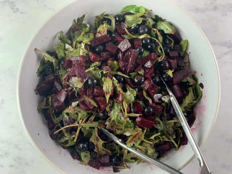 TOSSING RED WHITE AND BLUE SALAD TO COMBINE