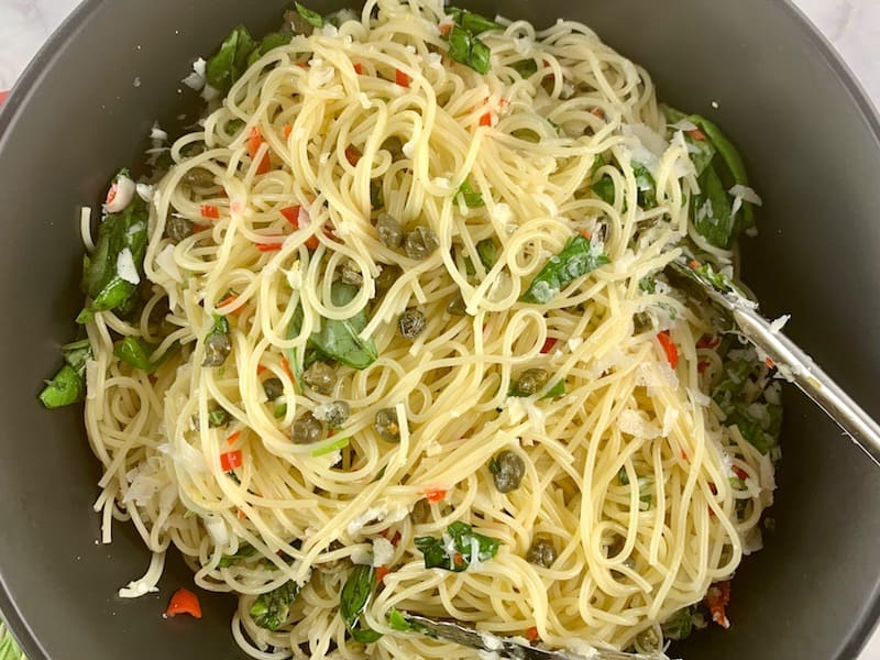STIRRING PARMESAN THROUGH CAPELLINI SALAD