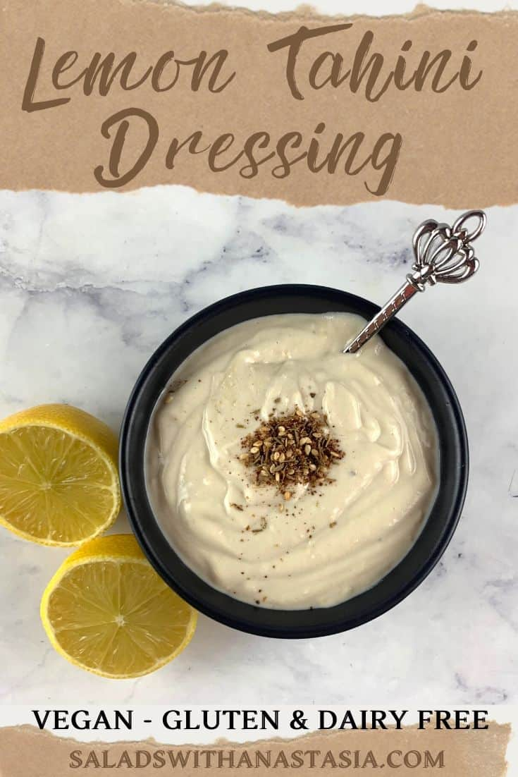 TAHINI LEMON DRESSING IN A BLACK BOWL WITH LEMONS ON THE SIDE AND TEXT OVERLAY