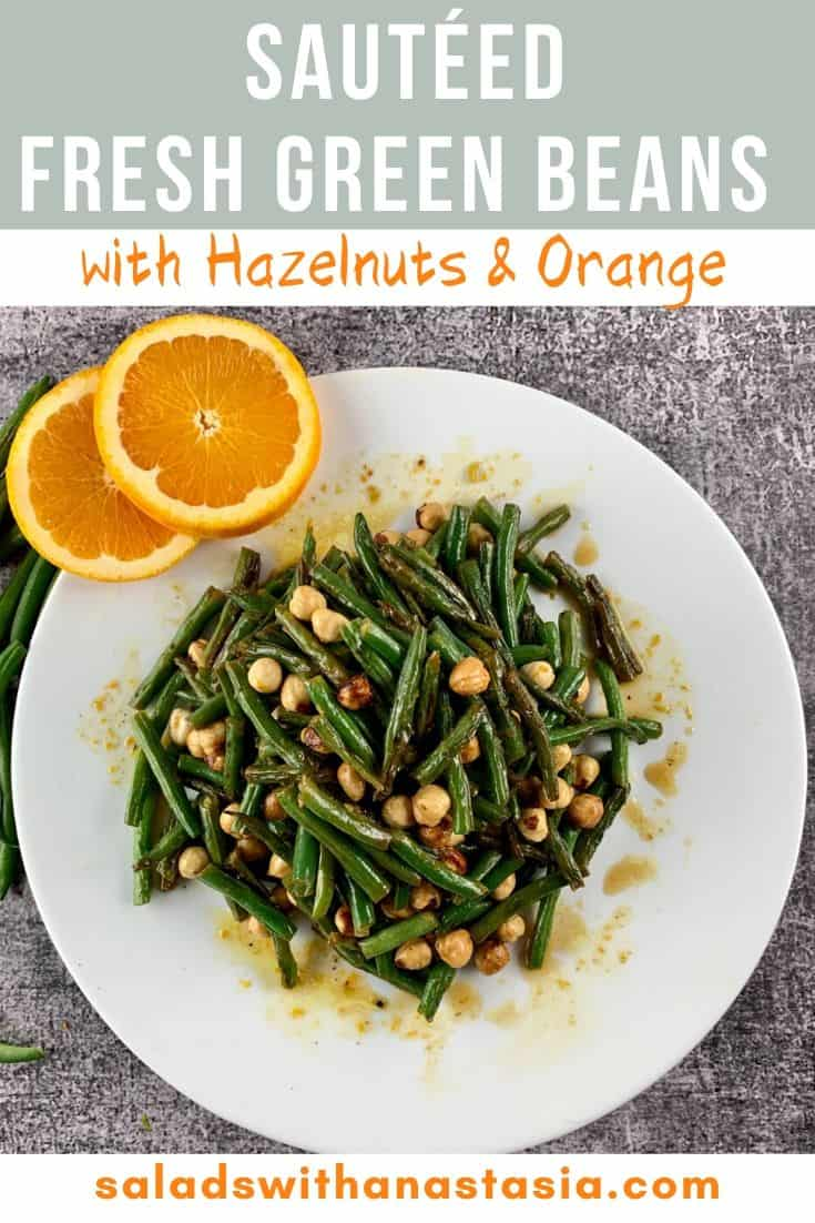 GREEN BEAN SALAD WITH ORANGE AND HAZELNUTS IN A WHITE PLATTER WITH ORANGE SLICES ON THE SIDE WITH TEXT OVERLAY