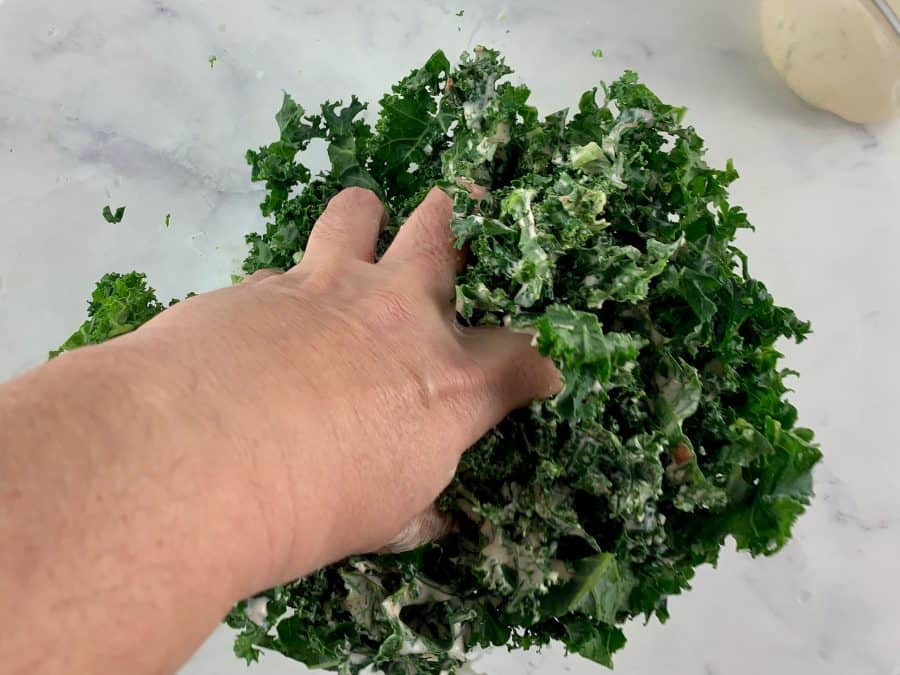 HAND MASSAGING KALE WITH DRESSING