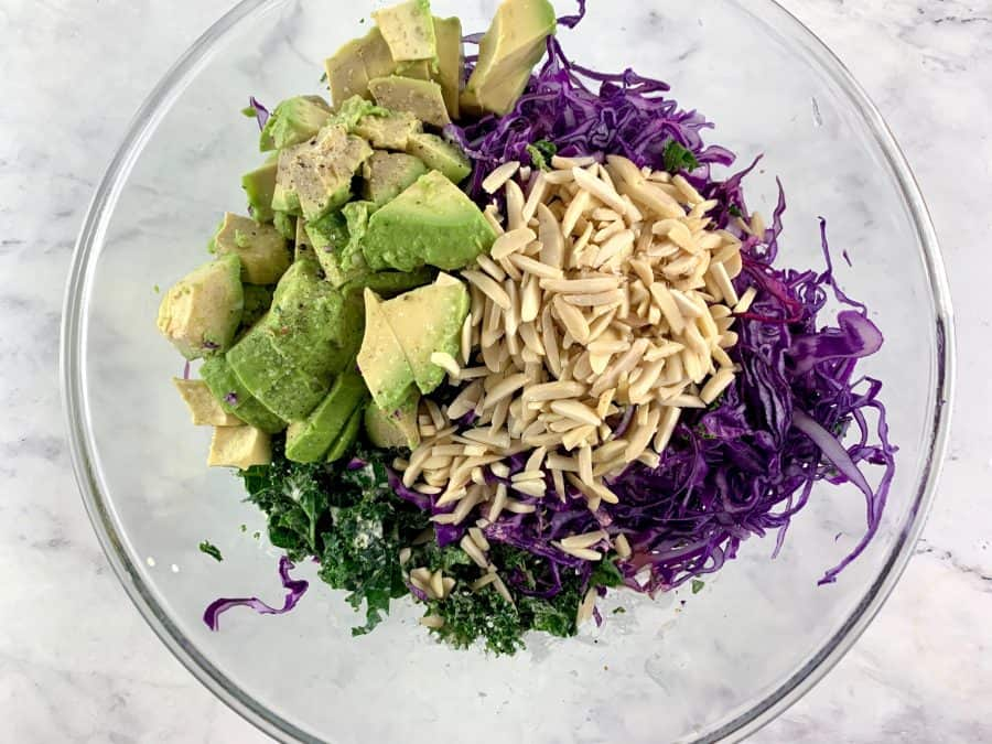 KALE AVOCADO SALAD INGREDIENTS IN MIXING BOWL