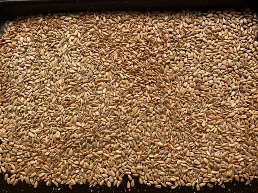 GOLDEN ROASTED SUNFLOWER SEEDS IN OVEN TRAY